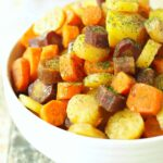 Slow Cooker Carrots with Herbed Honey Butter Sauce