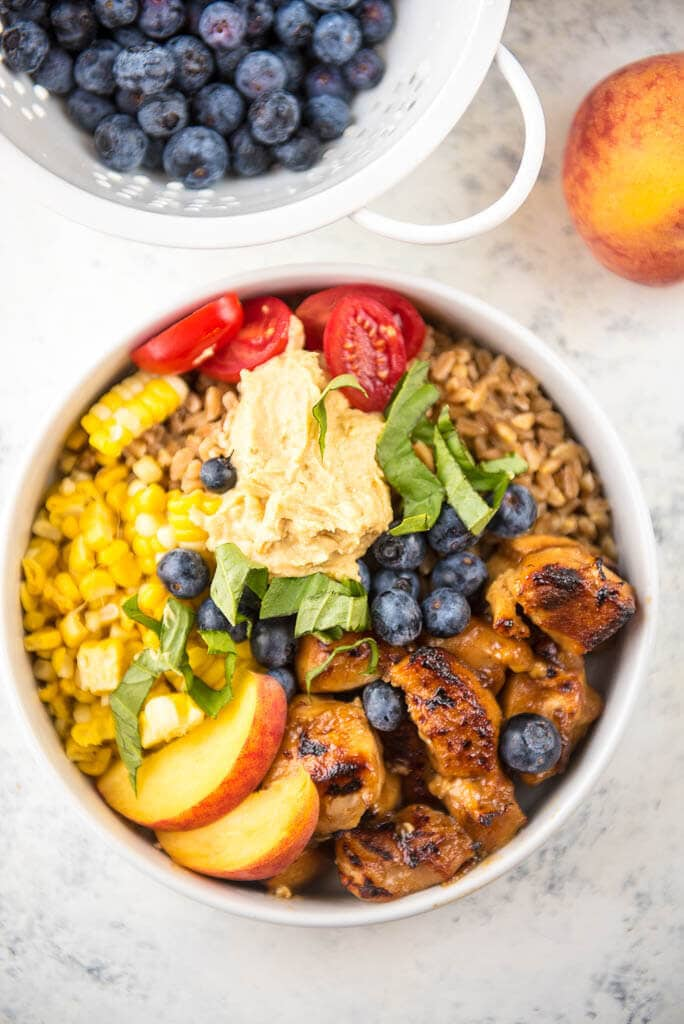Slow Cooker Peach Balsamic Chicken Bowls are a simple and fresh summer meal perfect for weeknight family dinners!