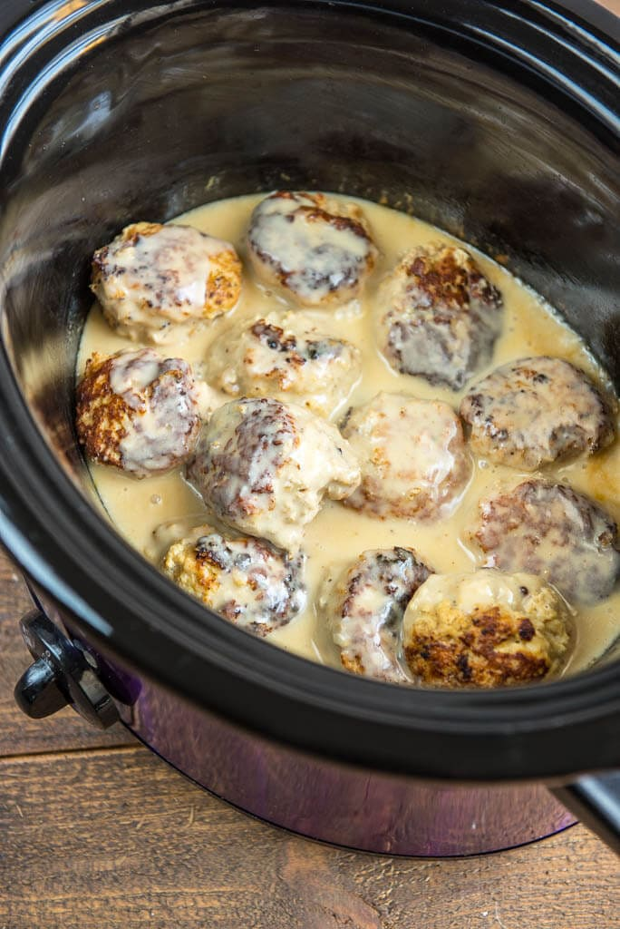 A flavorful seasoning blend makes these Slow Cooker Chicken Meatballs with Cream Sauce a quick and delicious weeknight meal idea!